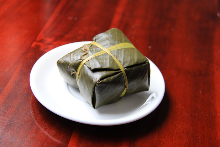 Banh Chung in banana leaf wrapper.