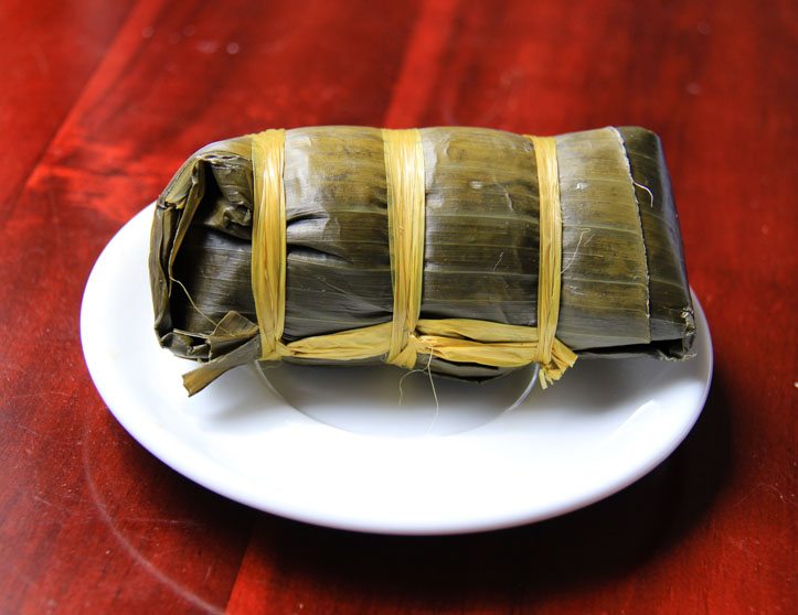 Banh Tet in banana leaf wrapper.