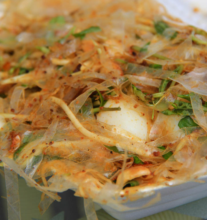 Takeout container of rice paper salad or banh trang tron