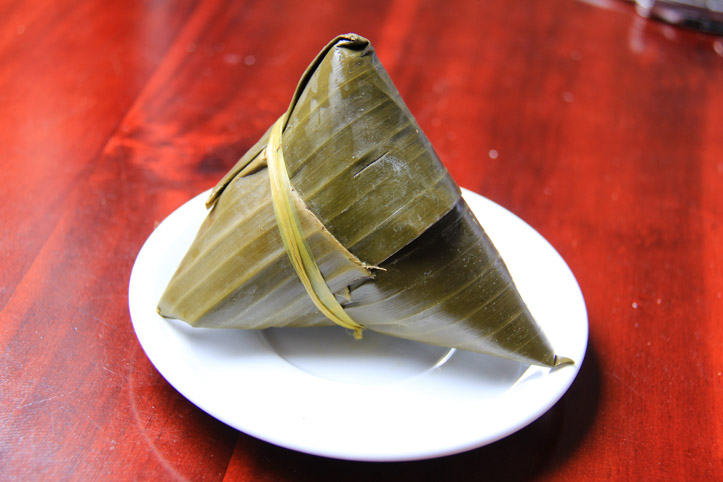 Banh U in banana leaf wrapper.