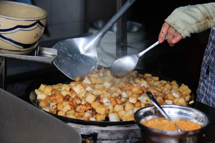 Fried rice cakes being cooked in Vietnam