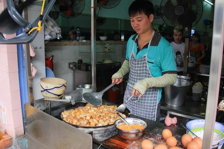 Man cooking bot chien in Vietnam