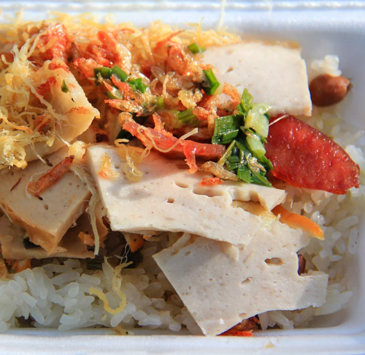 Takeout container of sticky rice or xoi man