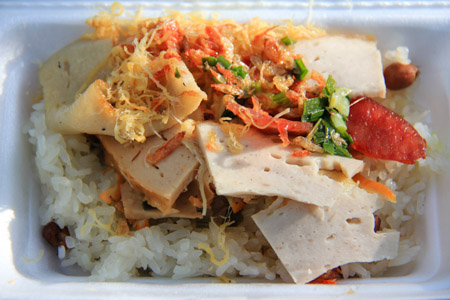 Xoi Man or Salty Sticky Rice topped with meats